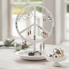 I love the Peace Earring Holder on pbteen.com or this?
