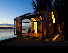 Seattle architecture has earned a reputation for integrated, systems-based design approaches. Looking at connections to the surrounding landscape and natural... Transformer Un Garage, Studio Mk27, Haus Am See, Vashon Island, Lakeside Cabin, Garage Renovation, Garage Makeover, Small House Design, Design Studio