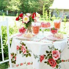 I love having a pretty table on the porch!  Roses from the garden make it even more special.