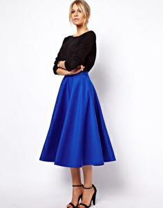 ASOS Full Midi Skirt in Scuba. I love the contrast of the black blouse and blue skirt. this would be great for a dressy occasion or a date. Great length, would definitely cover knees standing or sitting.