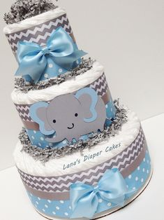 3 Tier Blue And Gray Elephant  Diaper Cake,  Baby Boy Shower Centerpiece by LanasDiaperCakeShop on Etsy https://www.etsy.com/listing/472059494/3-tier-blue-and-gray-elephant-diaper