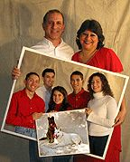 Economides Family Photo - 3 separate shots with a little photoshop magic. Steve  & Annette were shot holding a picture frame wrapped in white paper. The kids held a slightly smaller Picture frame wrapped in white paper. The background was a beige painters tarp.  The smaller photos were superimposed as layers in photoshop.