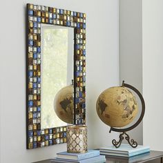 Lazuli Mosaic Mirror  $249.00 Looking for a piece that will tie in with the color story of your room? Consider the Lazuli Mosaic Mirror. The sturdy wrought iron frame is bedecked with oversize square mosaic tiles in shades of blue, bronze, gold and clear glass. Just think of the possibilities. You can have a field day coordinating design elements with this beauty.