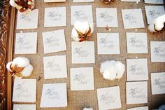 Elegant escort cards with cute touches of cotton