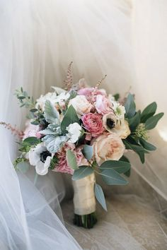 Romantic Bridal Bouquet with roses, anemones, dusty miller and eucalyptus. Wedding colors in ivory, blush, pink, sage, and hunter green.  Floral Design: www.papertini.com  Photography: www.brookecourtney.com
