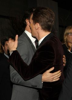 Cumberbatched --- guessing from the group picture and suit that it is Richard Armitage with Benedict Cumberbatch.