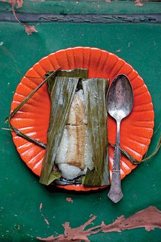 Coconut cream, sticky rice, and bananas are tucked inside banana leaves and steamed together for a pudding-like dessert. See the recipe »