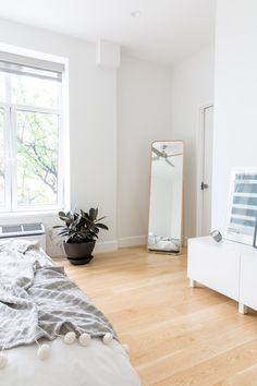 A single IKEA mirror tucked into the corner is both useful and stylish.