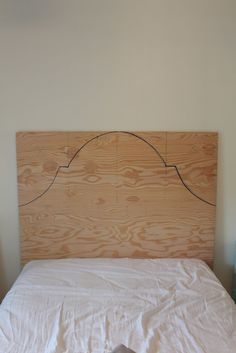 DIY headboard for $46? Yes! AND I can probably add the nail trim that I really like. Need to find some great black/grey fabric!