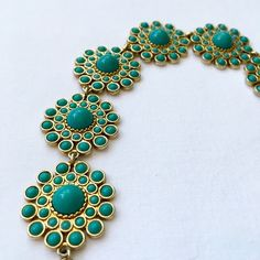 Circle Medallion Link Toggle Bracelet Quality costume jewelry. Six gold tone medallions with faux turquoise beads. 8.5 inches in length, 1 inch wide. To circle chains for length adjustability.. There is a identifying tag but for the life of me I cannot read it!❤️ Jewelry Bracelets