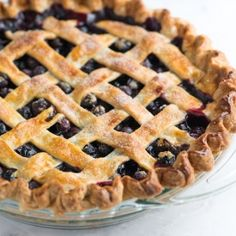 A simple blueberry pie recipe with blueberries, warm spices, lemon and a lattice crust. Tips for making with fresh or frozen blueberries.