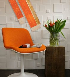 "Bursts of color and clean lines are a distinct addition to this retro interior.  Fotiou moulding: 5947OR (1"") and 5945OR (2"") from the Lacquer Collection #framing #pictureframes #interiordesign #homedecor #moulding #fotiouframes #orange #retro #lacquer"