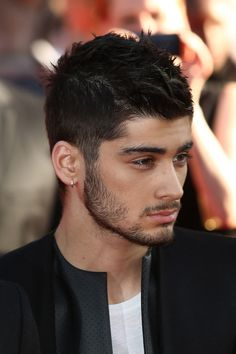 One Direction member Zayn Malikattends the World Premiere of 'One Direction: This Is Us' at Empire Leicester Square on August 20, 2013 in London, England.