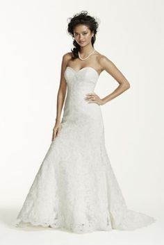 Feminine and elegant, this strapless sweetheart trumpet gown is classically beautiful.  Beaded lace on the shirred tulle bodice accentuates a flattering shape while the sweep train adds just the right amount of glamour.  Also available in Regular and Extra Length. Check your local stores for availability. *Special Value: Was ,050.00; Now ! (final selling price; no additional discount may be applied). Cherish your wedding dress forever with our Gown Preservation Kit