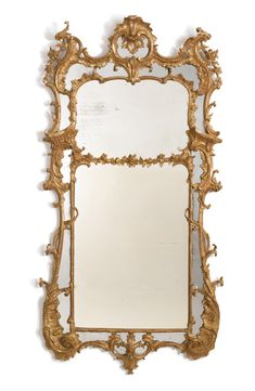 A fine George III giltwood pier mirror circa 1760 Fitted with two rectangular mirror plates, the upper smaller plate within a rocaille form banding, the lower plate with foliate cresting and molded banding each within and outer frame centered by mirror plates within a foliate carved frame made up of conjoined C-scrolls, the upper corners with large rocaille-carved S-scrolls flanking a mirrored cartouche cresting carved with pierced rocaille work, the bottom C-scrolled corners carved with…