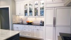 Gallery - Keidel Supply - White Traditional #kitchen with glass inserts. Beautiful!