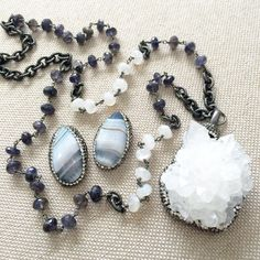 Like a crisp, dark winter  sky, Iolite, in #shifting #shades of #violet-blue carries the #spirit  of #journey , of #dreams  and #intuition , or #exploration and #illumination. Combined in this #gorgeous #raw #quartz #necklace is an #amazing #Iolite and #moonstone  #chain to give it a more #unique #look. Pair it with a #blue #lace #agate #stud #earring and you have an #outstanding #combination