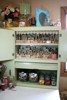 Stamp & embellishment storage - looks like a repurposed kitchen cabinet, with a garage on it - great idea!