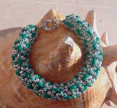 O-Caribbean Bracelet beaded by Elenia Cicirelli. Beautiful colors.Thank you for sharing!