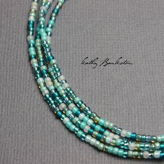 Multicolor blue green seed bead necklace. All the colors a mermaid might wear! Colors include greens, blues, silver, opaques and translucent. Very pretty mixture of beads. The necklace will be made to