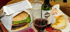 "Billed as the ""Sabores Mendocinos"" menu, the meal includes a double-patty burger of Angus beef, two meat empanadas, and a 187mL glass bottle of local Malbec produced by Bodega Santa Julia. Want to sample it? ""Sabores Mendocinos"" will cost you 47.00 Argentinean pesos, or $10.80 USD"