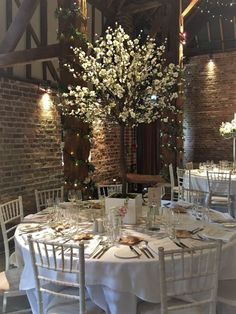 White blossom tree centrepiece by one of our recommended suppliers Floral Explosion