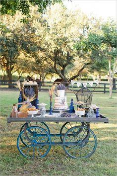 wedding cake wagon table ideas #caketable #rusticwedding #weddingchicks http://www.weddingchicks.com/2014/04/07/rustic-lush-lavender-wedding/