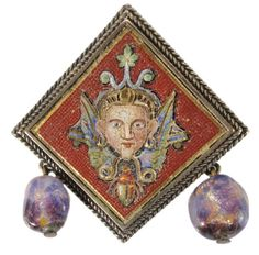 Rare 14 Kt. Gold Micromosaic Pharaoh Brooch  Italian, probably Venetian, 19th century, pharaoh head with full regalia and beard over a scarab, micromosaic with gold accents on red ground, Murano glass bead drops, mount (tested) 14 kt. gold, 1-1/8 x 1-1/8 in., minor losses of tesserae, possible repair to pin fastener Provenance: Private Collection
