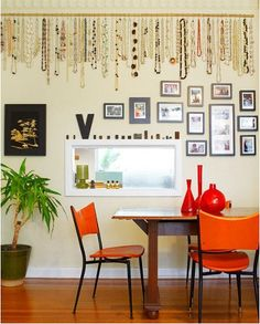 wall of necklaces, great idea. Love to display jewelry as art when not wearing it!