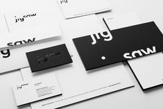 Jigsaw identity applied to black foil stamped stationery.