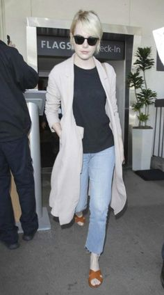 Emma Stone looked stylish and chic as she stepped out of the LAX airport in Los Angeles on June 7, 2016 after jetting in from New York City. The 27 year old decided to dress up in a layered ensemble comprising of blue boyfriend jeans, black blouse and long taupe jacket as she returned home after completing her work commitments in NYC. She was recently seen in a pre-recorded fake interviews segment aired on Saturday Night Live.