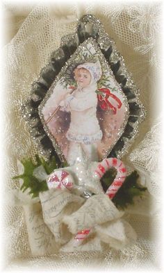 This darling Shaaby Chic ornament is set in a vintage tart tin. The tin and image are edged with Silver German glass glitter. A stamped rag Christmas Ornaments To Make, Pink Christmas, Christmas Projects, Handmade Christmas, Holiday Crafts, Christmas Decorations, Christmas Mantles, Christmas Stuff, Christmas Themes