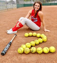 Softball pose. Jersey or year number spelled out with balls and bat.