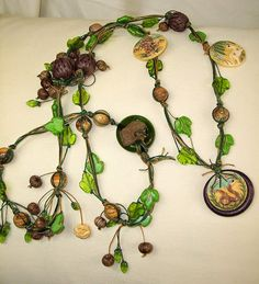 Jungle theme carved bone waxed linen necklace The by PyxeeStyx, $75.00  I like the different shades of the green used in the leaves and the way it represented the vines in the jungle