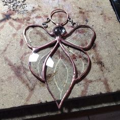 I am adding some scroll work to a stained glass beveled Angel Suncatcher. Look for it soon in the shop! And be sure to stay tuned for more shop updates d(^_^)b