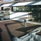 Obra completa, instalación de tarima exterior en club nàutic cambrils, escalera, vallas, celosía.