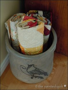 old quilts in a crock...love this idea