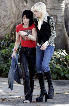 Kristen Stewart and Dakota Fanning in a scene from The Runaways    Love Dakota Fanning's outfit.