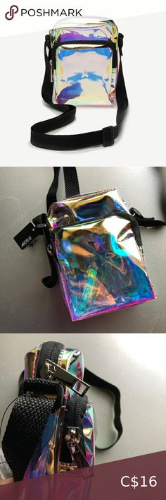 Clear mini crossbody Mini holographic clear crossbody. Two pocket & adjustable strap. 6 x 4 x 2 inches Ardene Bags Mini Bags Mini Purse, Mini Bag, Tan Cross Body Bag, Yellow Handbag, Mini Hands, Floral Bags, Cute Backpacks, Ariel The Little Mermaid