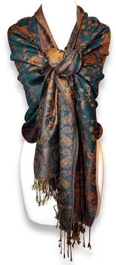 "Peach Couture Reversible Paisley Pashmina Shawl Wrap in Elegant Colors      Peach Couture (A Registered Trademark)     Luxurious Touch & Reversible; Soft, Silky & Elegant.     Beautiful Jacquard Paisley Design is Available in a Variety of Different Colors     Dimensions : 28"" width x 70"" length. Fringes - 3"" length. Double layer.     Lightweight & Fashionable easy to carry... Perfect Accessory for any season."