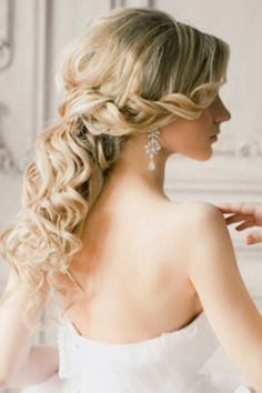 Loose braid, pulled back low. Perfect wedding hair.