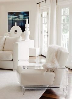 @ Alison Seeger - woah lucite and leather arm chairs THANKS LISA! yes, and the sheepskin draped over the chair...