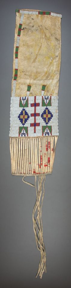 American Indian Art:Beadwork and Quillwork, A SIOUX BEADED HIDE TOBACCO BAG. c. 1900.