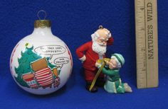 """""""A Fitting Moment - Mr. & Mrs. Claus"""" Hallmark  Keepsake Ornament is Eighth in the Series in the  Hallmark Collector's Series.  It is Mrs. Claus dressed in green measuring Mr. Claus who is dressed in red.  """"Cartoon Character"""" Hallmark Shoebox  Ornament - """"The Tree Looks  Wonderful"""" & """"...And Straight, Too""""."""