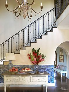 A wainscoting of thick, old Portuguese tiles is accented by well-seasoned blue-and-white Moroccan pottery in the enlarged front entry. - Traditional Home ® / Photo: Dominique Vorillon / Design: Lynn von Kersting Love the colors and the vibe Spanish House, Spanish Style, Spanish Revival, Spanish Colonial, Vintage Farmhouse, Feng Shui, Traditional Home Magazine, Indigo, Portuguese Tiles