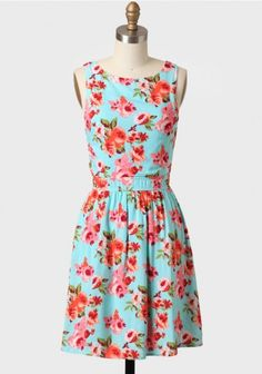 Adore the teal and coral palette to this floral print