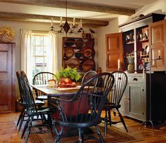 A reproduction double-cone wire chandelier complements a farmhouse dining room furnished with a mix of antiques and reproductions. Primitive Homes, Primitive Dining Rooms, Country Dining Rooms, Primitive Kitchen, Country Kitchen, Primitive Decor, Primitive Country, Country Homes, Primitive Bedroom
