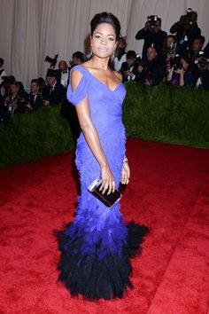 Naomie Harris in a Donna Karan Atelier cornflower blue dress with ruffled mermaid train.