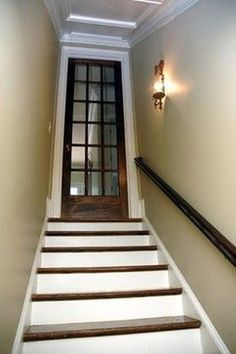 Martina Basement Staircase - traditional - staircase - atlanta - Phoenix Renovations//I like the idea of a glass door at the top of the basement stairs Basement Staircase, Basement Doors, Basement House, Basement Flooring, Basement Bathroom, Staircase Design, Modern Basement, Gray Basement, Flooring Ideas