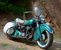 """Wheels Through Time Photo of the Day- """"The Green Dragon"""". In 1950, Indian debuted their 80 cubic inch Chief, which included a new Hydraulic Fork for a smoother ride. This example features ultra-rare Indian accessory """"bubble"""" hard bags with hinged tops and key lock. It was found in Cocoa, Florida in 2010 and is on display at Wheels Through Time."""